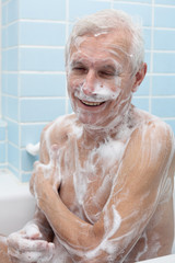 Happy senior man bathing