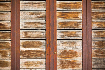 Wooden planks surface with rusty metal bands background