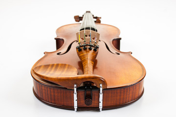 Violin from the bottom lying on white surface