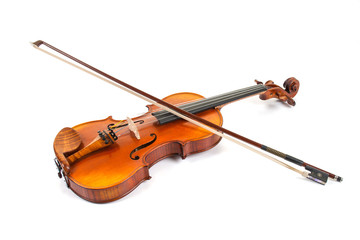 Violin and bow on white surface