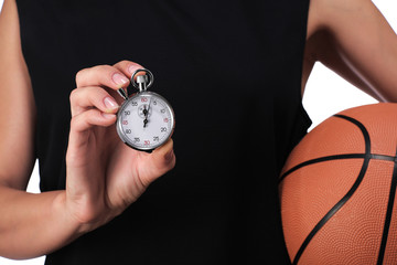 basketball player showing a stopwatch