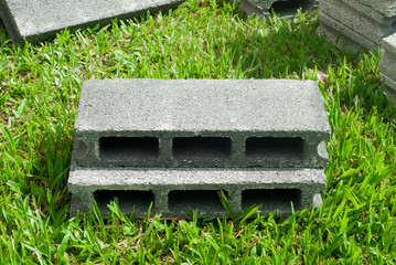 Concrete blocks on grass