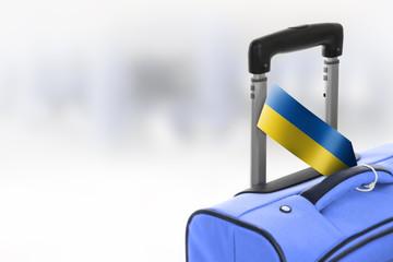 Destination Ukraine. Blue suitcase with flag.