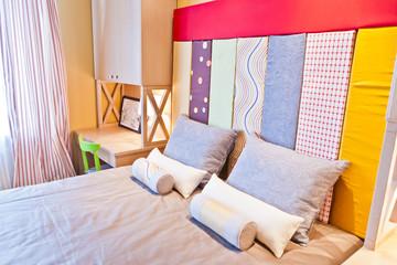 Кровать в спальне / Bedroom