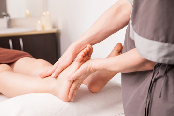 Foot massage for a woman in luxury spa