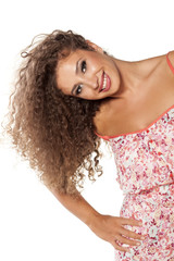 happy young woman with curly hair