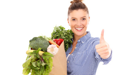 Happy woman with vegetables showing ok