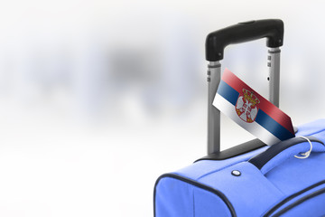Destination Serbia. Blue suitcase with flag.