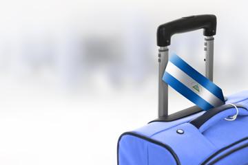Destination Nicaragua. Blue suitcase with flag.