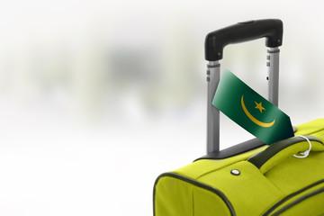 Destination Mauritania. Green suitcase with flag.
