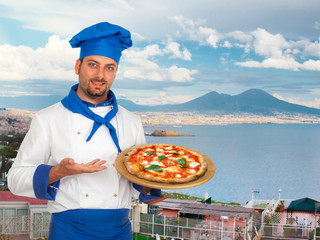 Young chef with neapolitan pizza margherita
