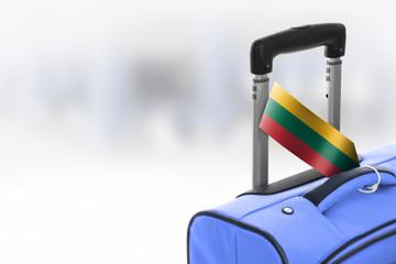 Destination Lithuania. Blue suitcase with flag.