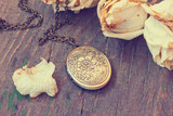 vintage bronze medallion close up
