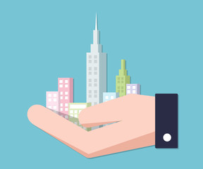 Hand holding city. city concept in businessman hand.