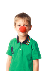 Little boy with clown nose isolated on white