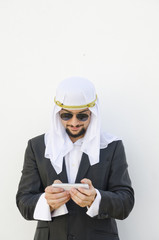 Arab man touching smartphone