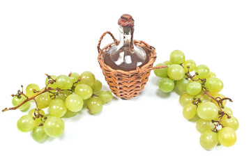Old sealed bottle of wine and white grape isolated on white