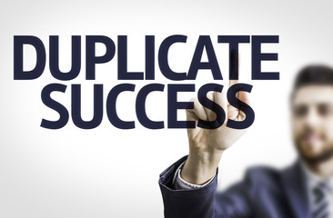 Business man pointing the text: Duplicate Success