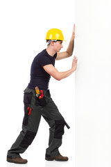 Repairman pushing the wall