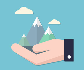 Mountain concept in businessman hand.