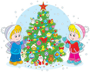girl and boy decorating a Christmas tree