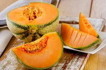 Melon on  wooden table.
