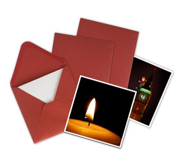 Christmas cards and red envelopes, white background.