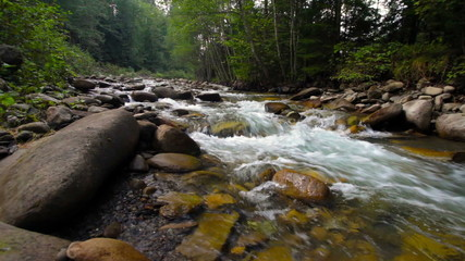 A river flows over rocks in this beautiful scene in the mountain