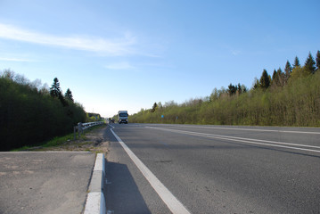 bicycle and heavy-duty trucks on the highway