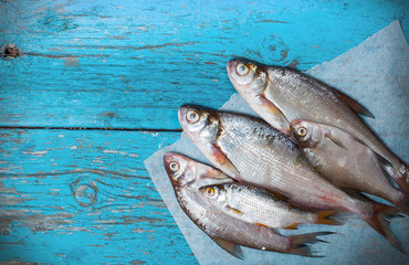 fresh fish a wooden background