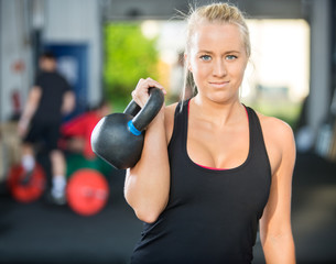 Beautiful Athlete Lifting Kettlebell