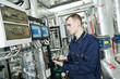 Leinwanddruck Bild - heating engineer repairman in boiler room