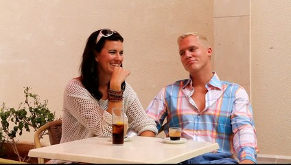 young smiling couple in cafe outdoor in summer