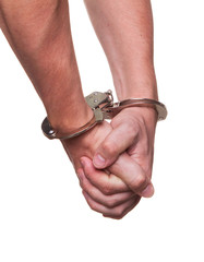 male hands in police handcuffs showing gesture isolated