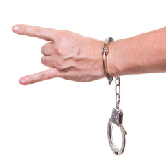 male hand in police handcuffs showing gesture isolated