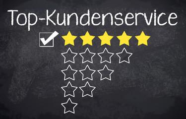Kreidetafel mit Sternen und Top-Kundenservice