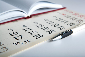 calendar days with numbers and pen