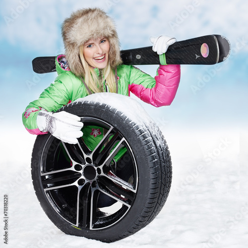 canvas print picture Woman with skiing gear and winter tyre