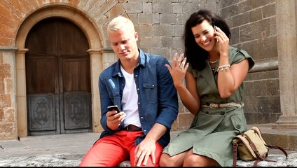 young happy couple summer outdoor with smartphone