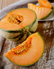Fresh  melon on a wooden table.