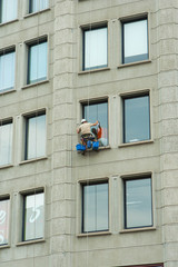 Window cleaner washing elevation of building windows