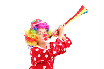 Female clown blowing a horn