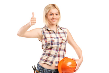 Female construction worker giving a thumb up