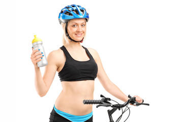 Female cyclist holding a water