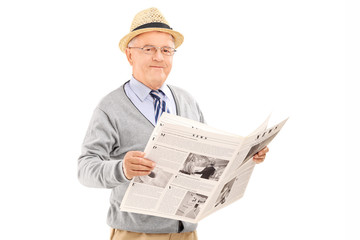 Senior gentleman holding a newspaper isolated on white backgroun