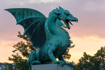 Dragon on the dragon bridge in Ljubljana at dawn