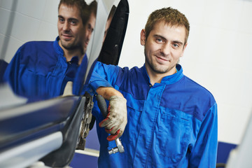 smiling repairman auto mechanic