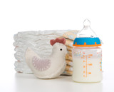 New born child composition stack of diapers toy and baby feeding