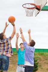 group of teenagers playing basketball