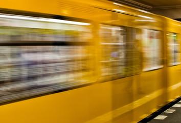 BERLIN - MAY 24, 2012: U-bahn train speeds up in subway station.